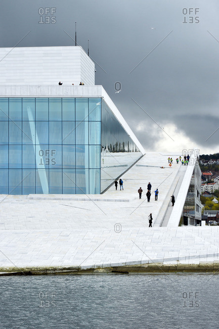 Oslo, Norway - April 30, 2015: People walking at Opera House in Oslo, Norway