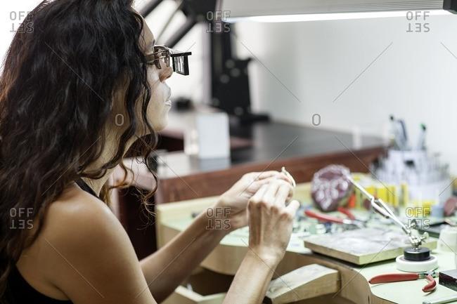 Woman working in a jewelry studio