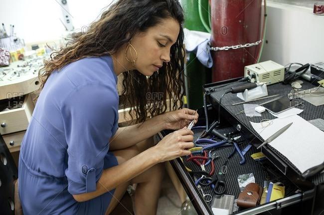 Professional working in a jewelry studio