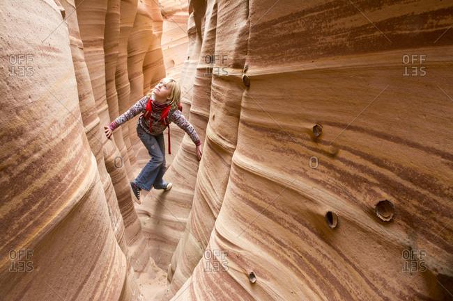 Girl in Zebra Slot Canyon, Utah