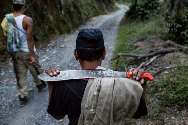 Men walking Colombian mountain trail