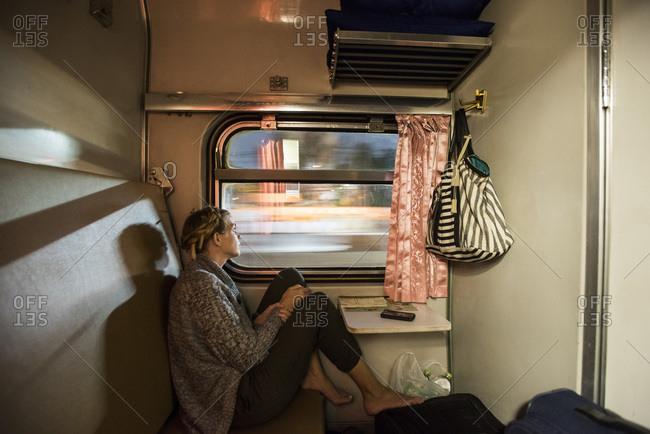Woman in train sleeper car
