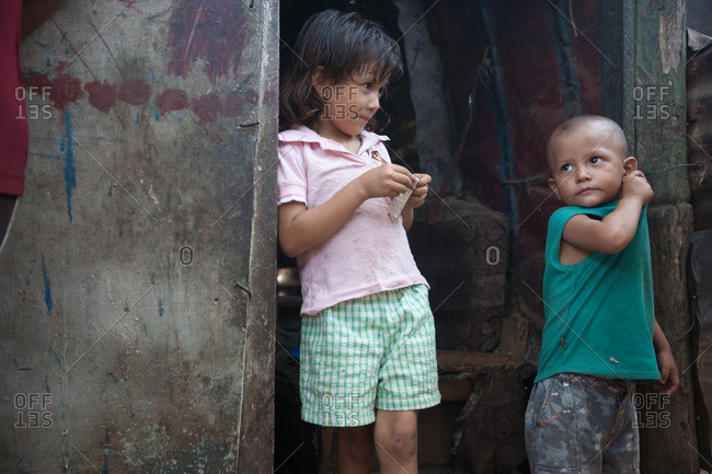 Nicaragua - May 1, 2009: Portrait of two children standing in a doorway