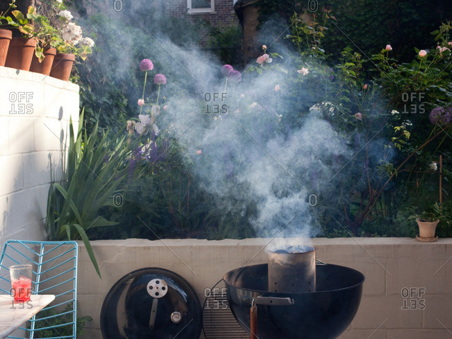 Charcoal smoking in backyard barbecue grill