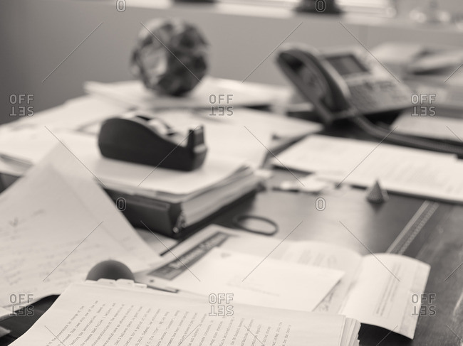 Documents on a desk in office