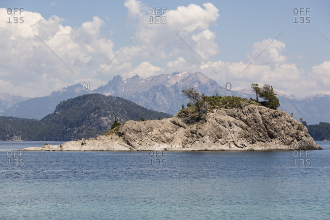 Scenic view of a small rocky island in Nahuel Huapi Lake in Neuquen, Argentina