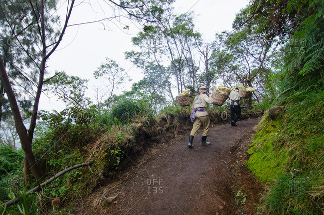 East Java, Indonesia - May 27, 2016: Man on mountain trail