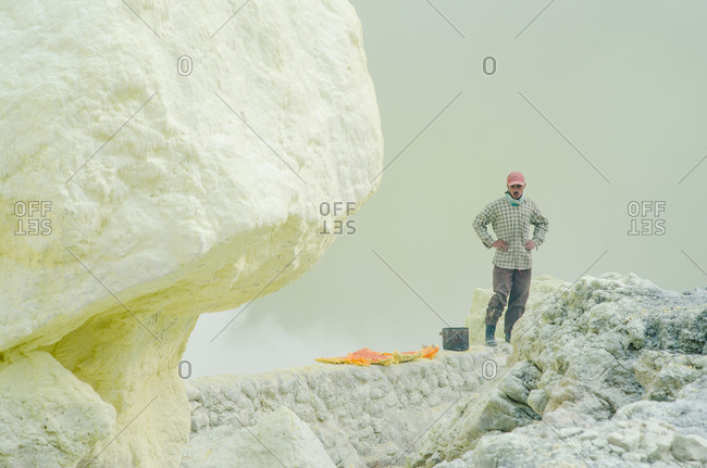East Java, Indonesia - May 27, 2016: Man in volcanic mountains