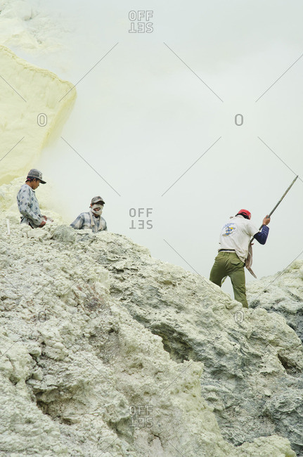 East Java, Indonesia - May 27, 2016: Men in rugged mountains
