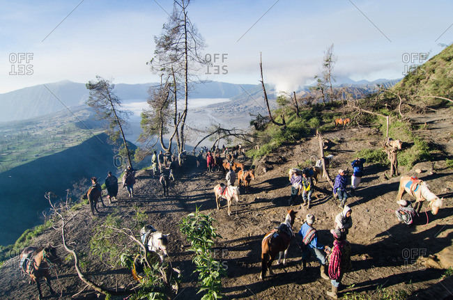 East Java, Indonesia - May 27, 2016: Indonesian tribe with volcano in background