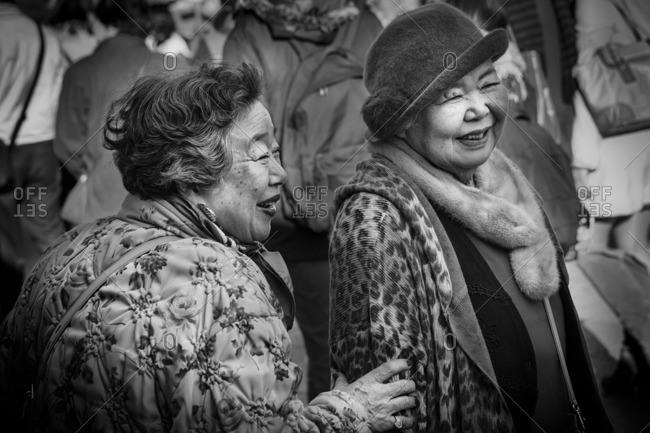Tokyo, Japan - December 23, 2014: Women laughing in Asakusa
