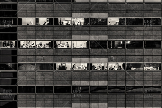 Tokyo, Japan - December 11, 2014: People working in offices