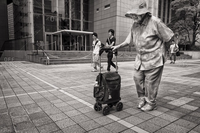 Tokyo, Japan - August 9, 2015: Elderly woman walking