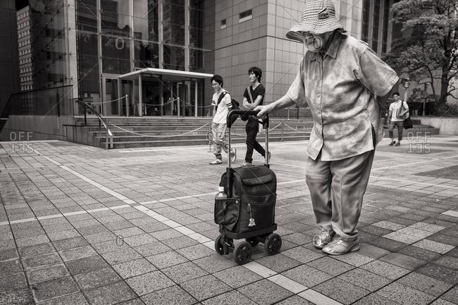 Tokyo, Japan - August 9, 2015: Elderly woman walking