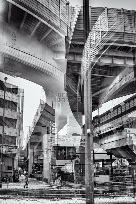 Tokyo, Japan - February 9, 2014: Double exposure of intersection