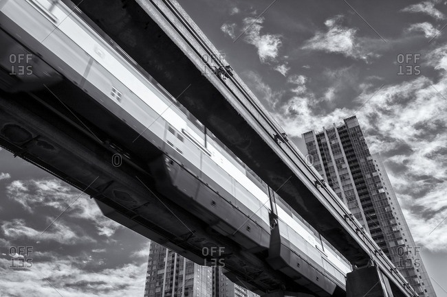 Tokyo Monorail with apartments behind