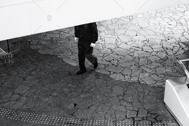 Guard walking underneath overhang, Tokyo