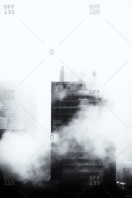Office tower shrouded in fog, Tokyo