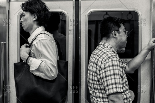 Tokyo, Japan - May 15, 2015: Commuters on the subway