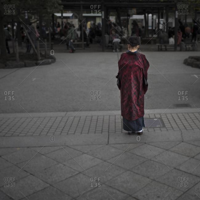 Woman in kimono at temple, Tokyo