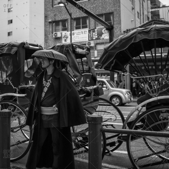 Tokyo, Japan - December 6, 2015: Rickshaw driver in traditional clothing