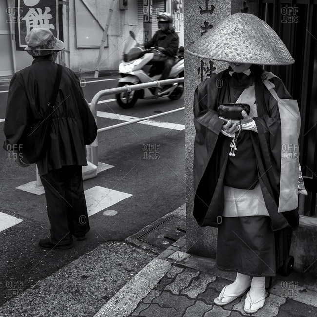 Buddhist nun begging for alms, Tokyo