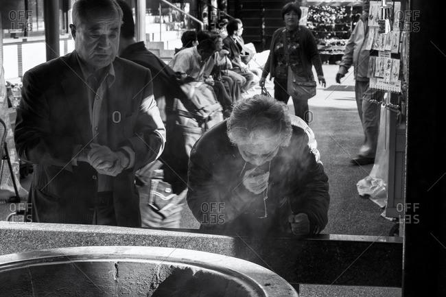 Tokyo, Japan - October 18, 2015: Elderly couple at temple, Sugamo