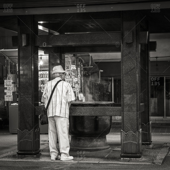 Tokyo, Japan - August 21, 2015: Elderly man at temple, Sugamo