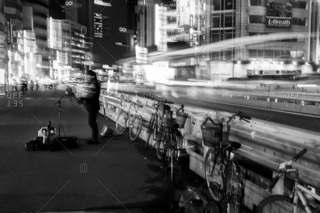 Tokyo, Japan - November 27, 2014: Street singer at Shinjuku station