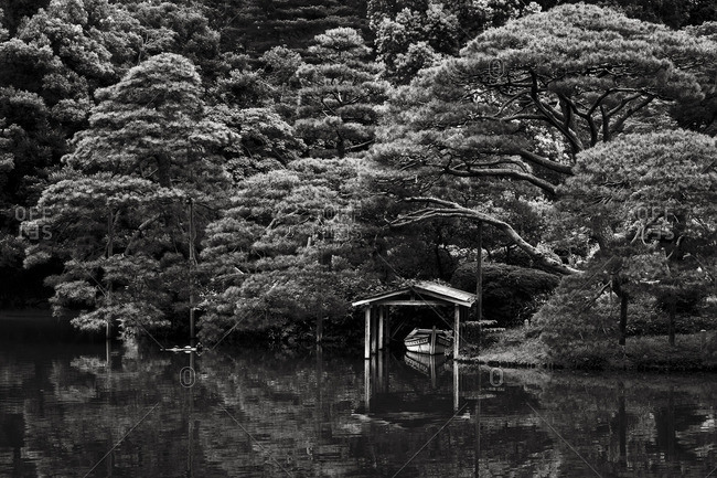 Small boat and boathouse on pond at Rikugien, Tokyo