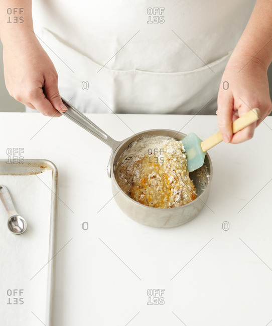 Chef stirring the ingredients to make cookies in a saucepan