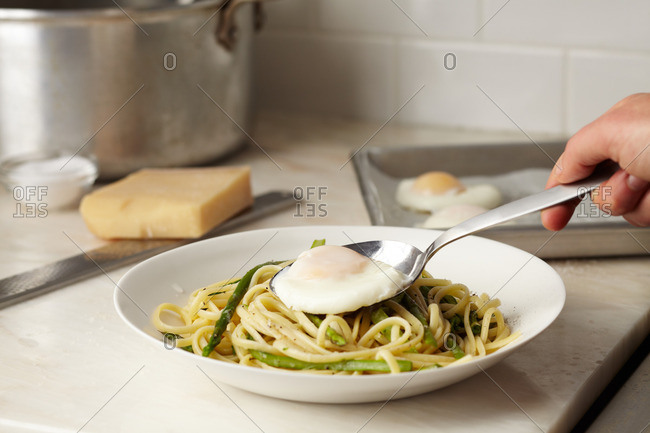 Linguine with asparagus and egg in a bowl