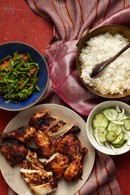 Overhead view of chicken, cucumber, rice, and bean salad