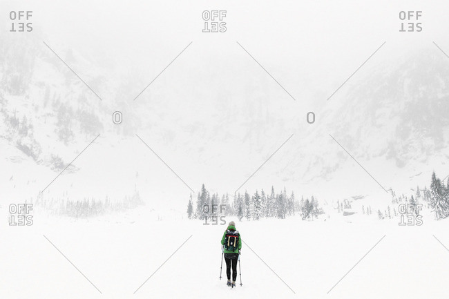 Woman skiing in snowy valley