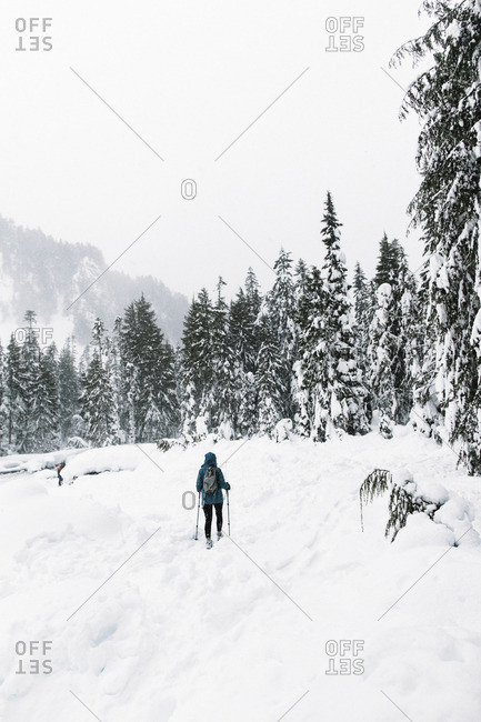 Woman skiing in snowy mountains