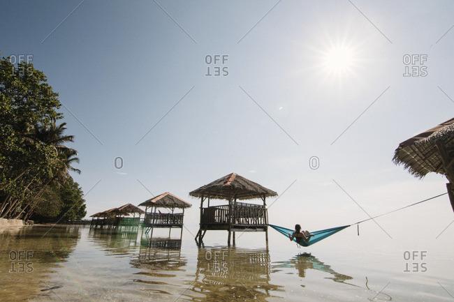 Woman in a hammock on sea