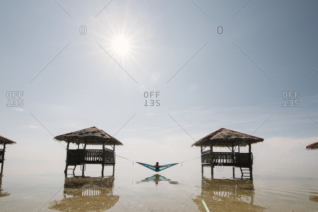 Woman in hammock on sea