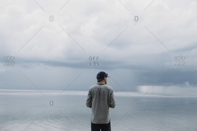 Man staring out to sea