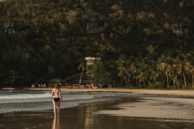 Woman walking a tropical beach