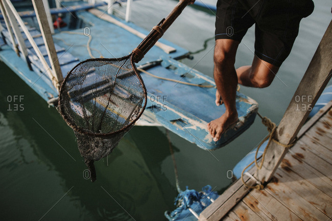 Person holding fishing net