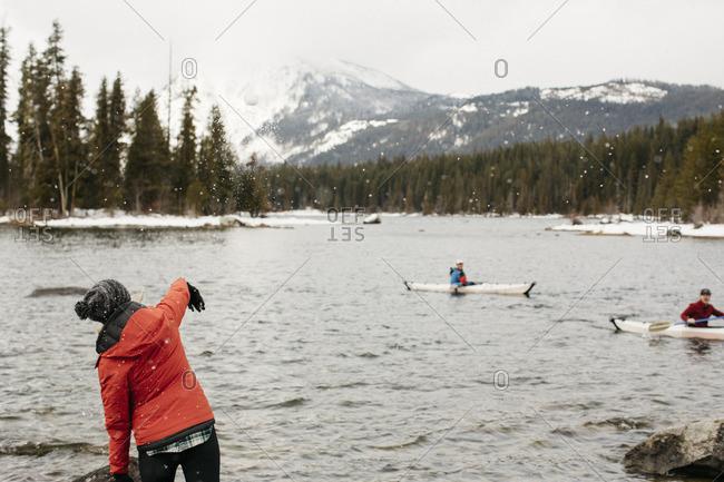 Kayakers on winter lake