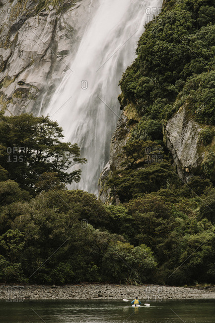 Kayaker near a waterfall