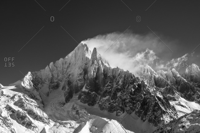 Snowy windswept mountain peaks - Offset