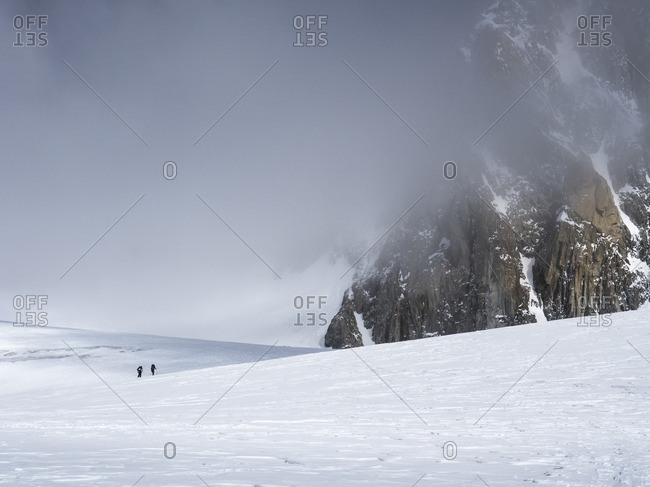 People hiking along a snowy mountainside