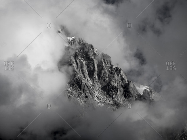 Rugged mountain peak surrounded by clouds