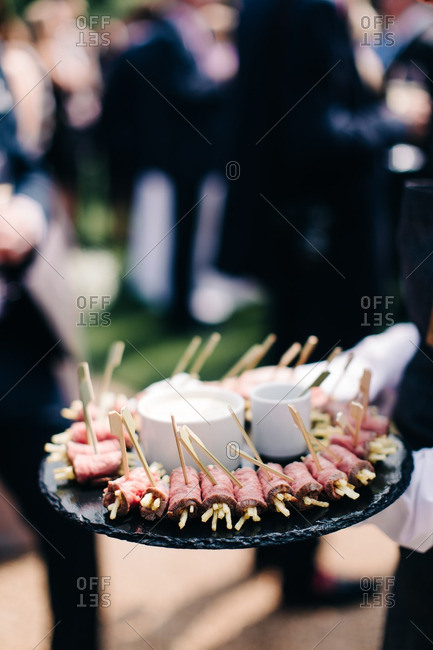 Waiter serving canapes at a wedding reception