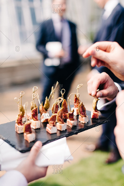 Waiter serving hors do oeuvres at a wedding reception