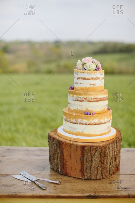 Layered wedding cake outdoors