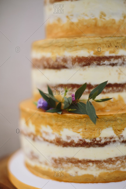 Layered cake with floral stem