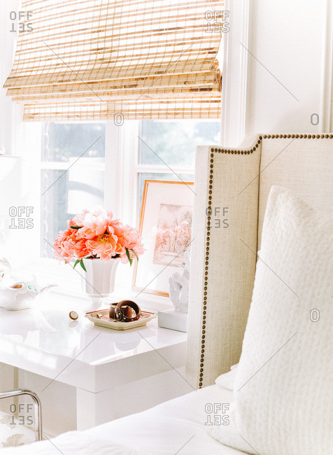 Stylish fabric headboard and white lacquered table